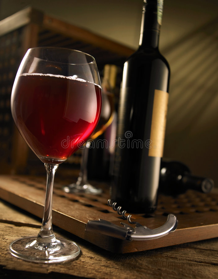 Red and white wine. Composition in mood lighting stock photography
