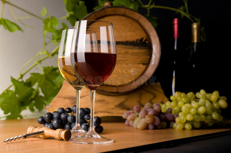 Red and white wine with grapes stock image