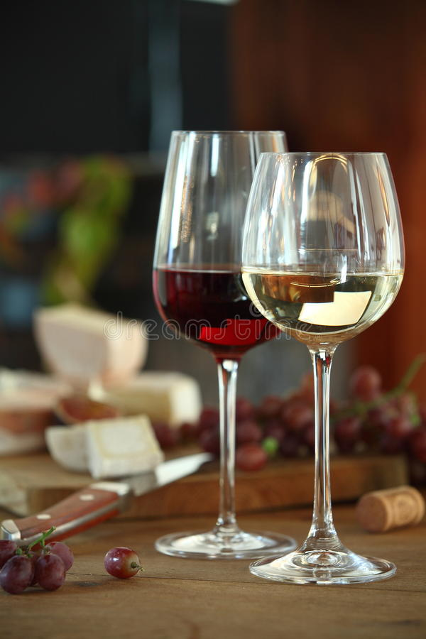 Red and white wine served with cheese royalty free stock images
