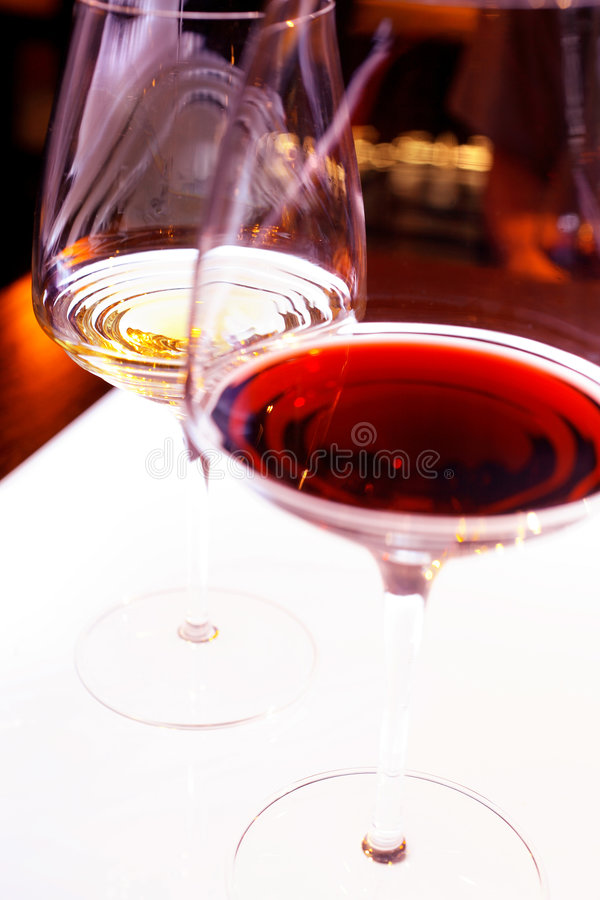 Red and white wine in stem glasses stock photos