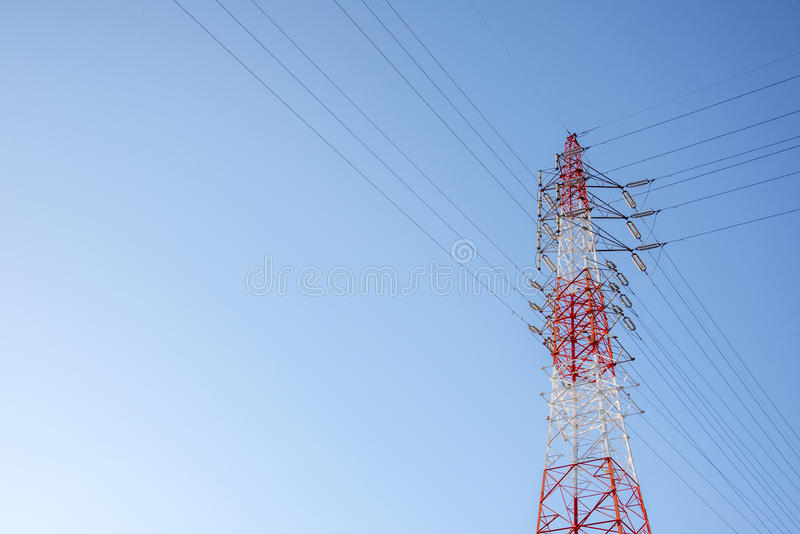 Red and white wired Electric cable Telecom post with blue sky background, technology concept royalty free stock image