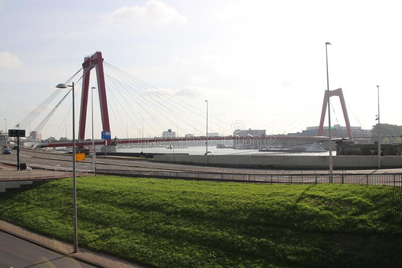 The red willemsbrug bridge in Rotterdam over river Nieuwe Maas to connect North part to the northern island named Noordereiland in royalty free stock photos
