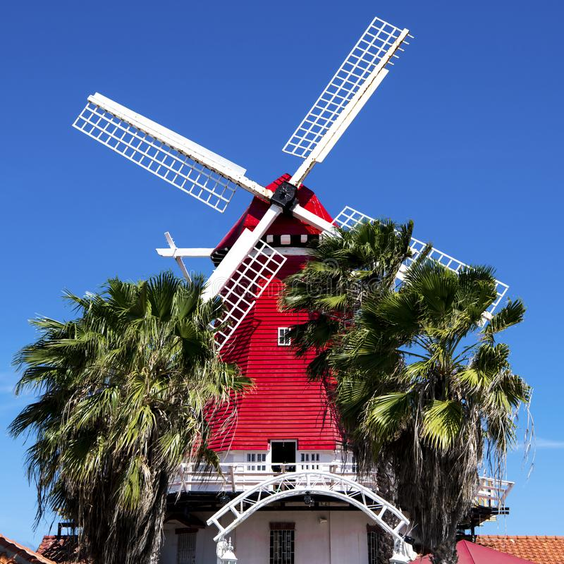 Red windmill and palms, Island Aruba stock photos