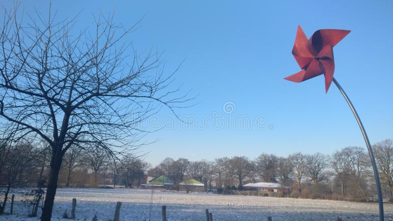 Red Windmill Postcard Golden Winter stock image