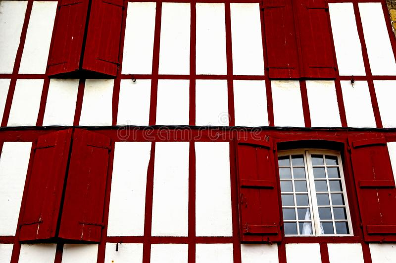 Red window - Espelette. Espelette is known for its dried red peppers, used whole or ground to a hot powder, used in the production of Bayonne ham. The peppers stock image