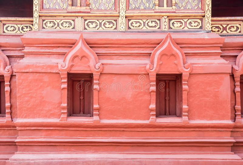 Red window frame of the Thai church stock photos