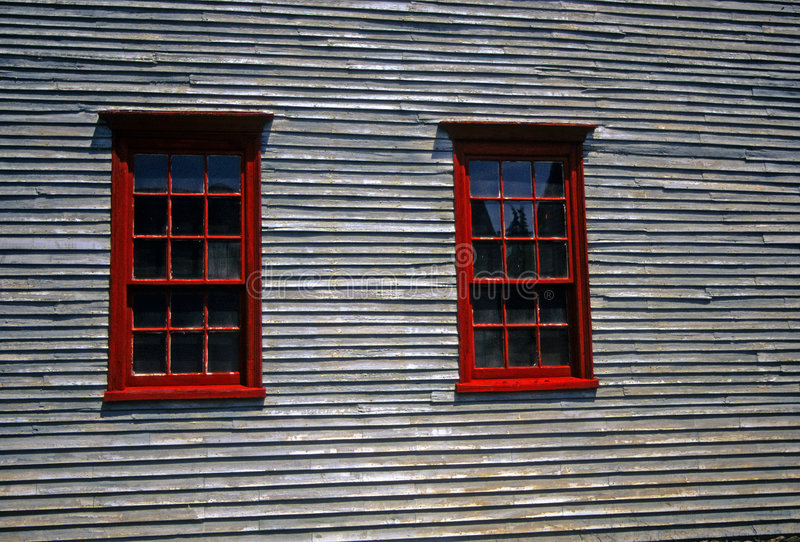 Red windows on 19th century clapboard house. Portsmouth, New Hampshire stock photography