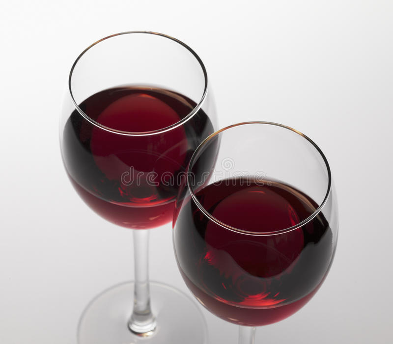 Red wine. In glass stemware royalty free stock photography