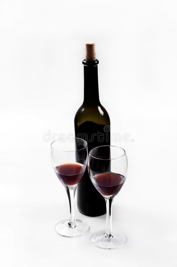 Red wine. Bottles and glasses on white background stock images