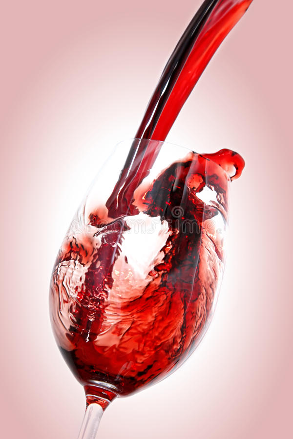 Red wine. Pouring into wine glass