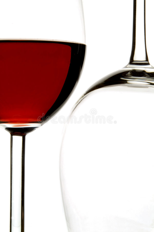 Red wine. Two glasses, one filled with wine