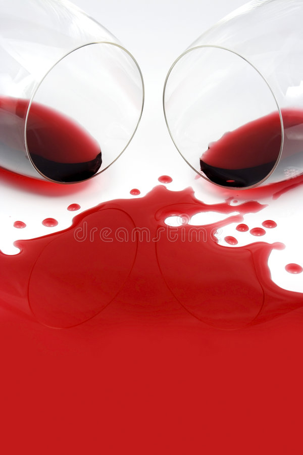 Red wine. Spilled from glasses royalty free stock images