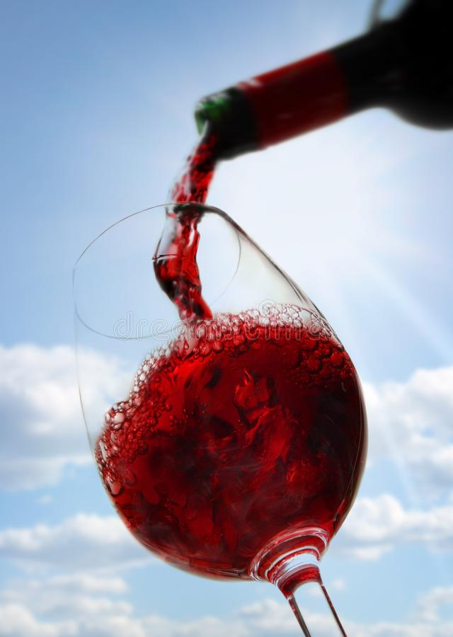 Red wine against blue sky stock photos