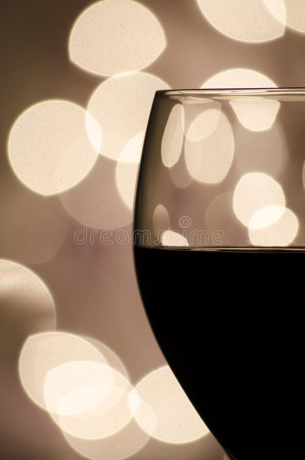 Download Red Wine Against Blurred Lights Stock Photo - Image: 27647028
