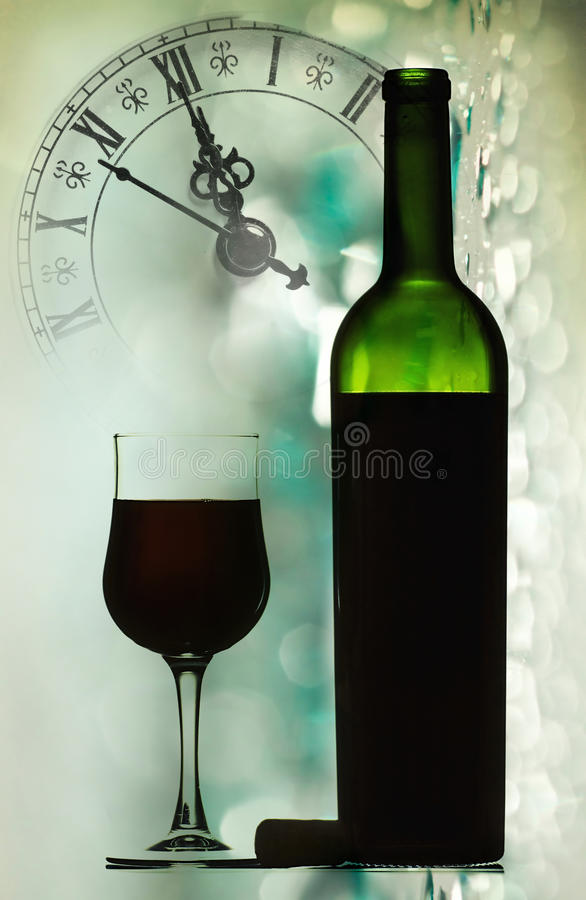 Download Red Wine Against Holiday Lights And Clock Stock Image - Image: 34729389