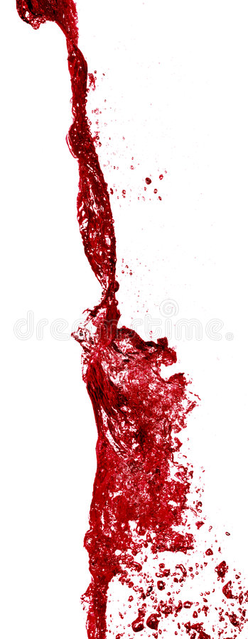 Red wine being poured from a bottle stock image