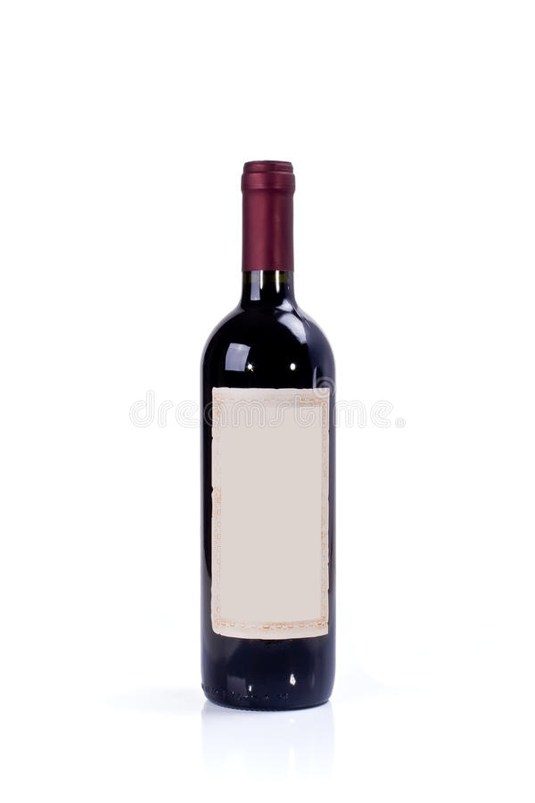 Red Wine Bottle. Red table wine bottle with a blank antique label isolated on a white background royalty free stock photo