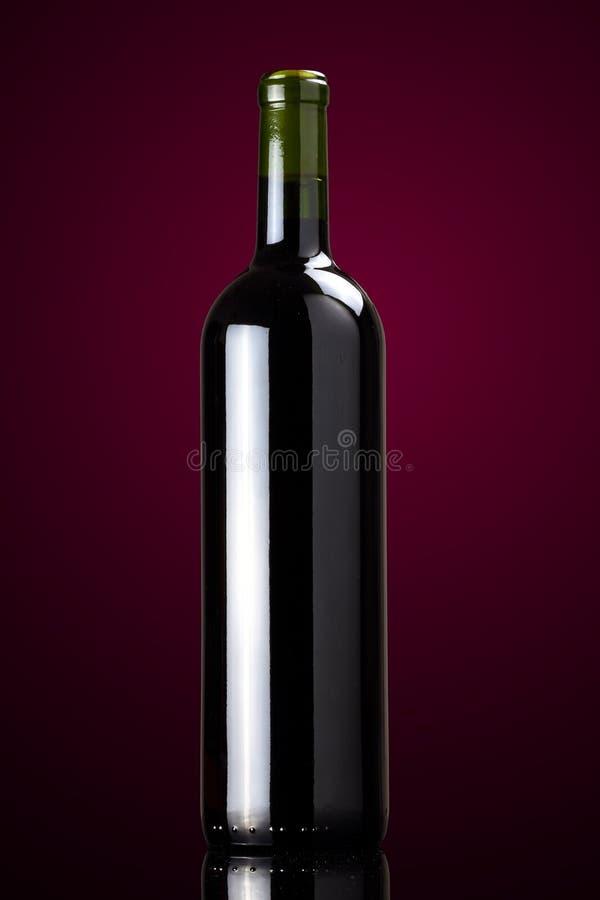 Red Wine Bottle. Elegant studio shot of red wine bottle stock photography