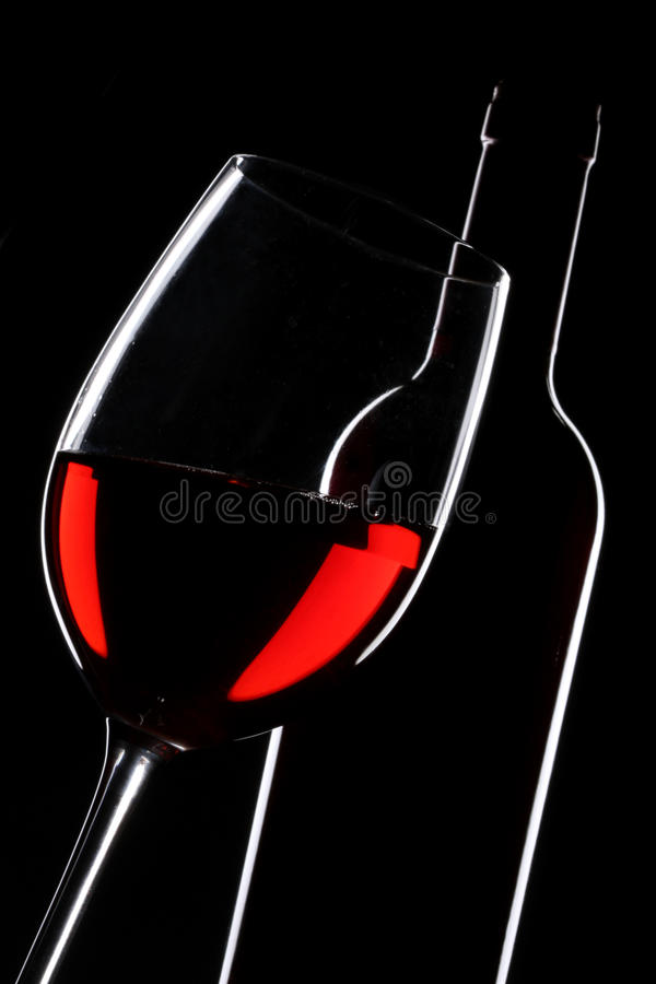 Red wine bottle and glass silhouette stock images