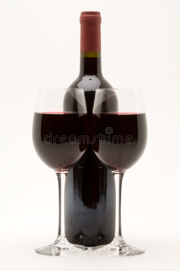 Red wine bottle with two glasses of red wine royalty free stock photos