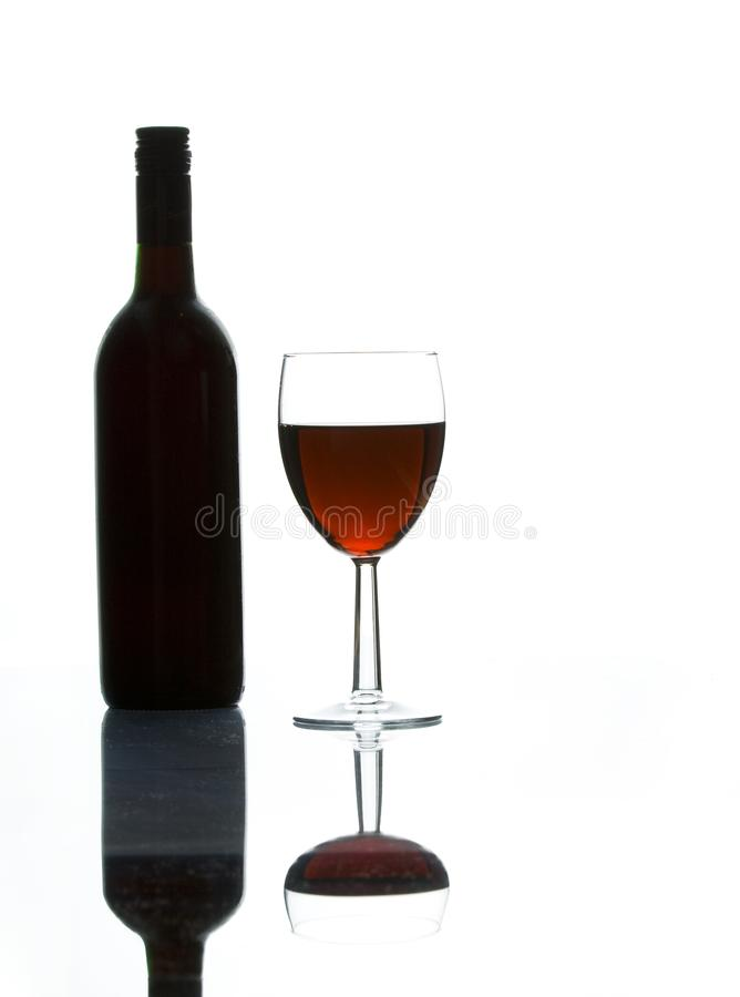 Red wine and a wine bottle royalty free stock images