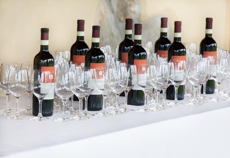 Red wine bottles stock image