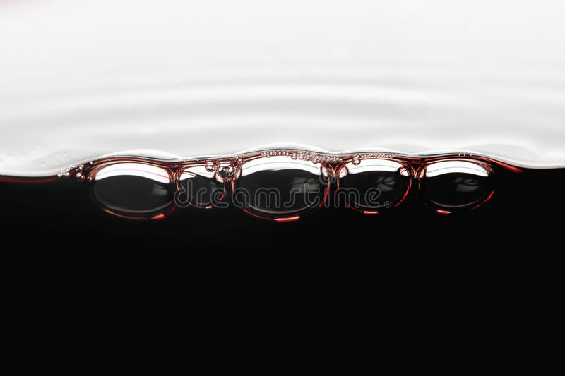 Red wine bubbles in a glass stock photo