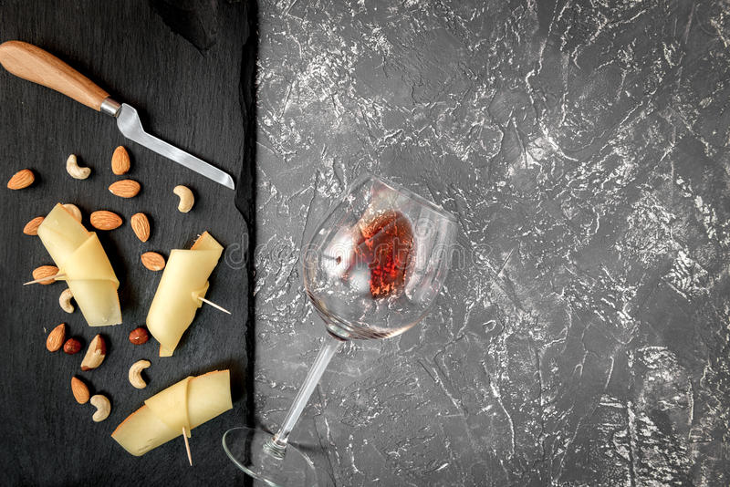 Red wine with cheese on dark background top view.  royalty free stock images