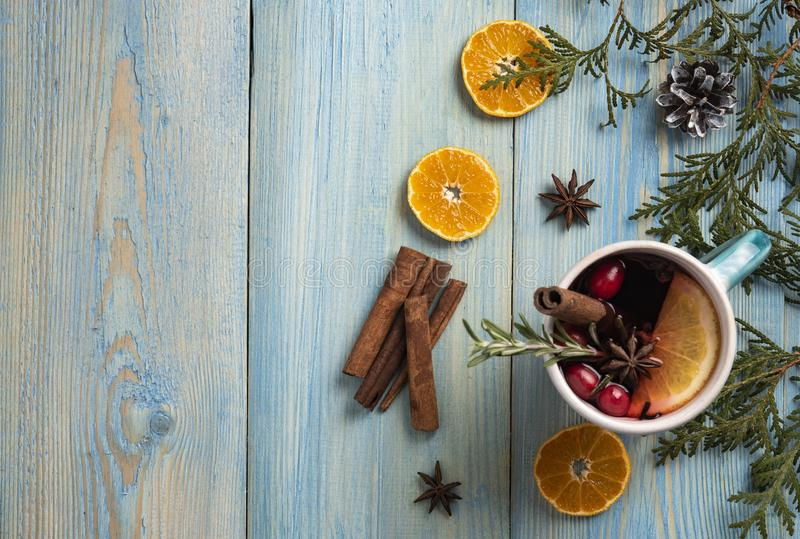 Red wine christmas blue background orange cinnamon top view royalty free stock photos
