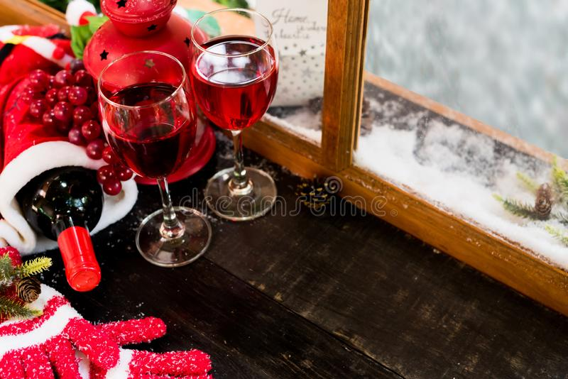 Red wine for Christmas and Happy New Year party. Winter season holiday with snow and decoration royalty free stock photos