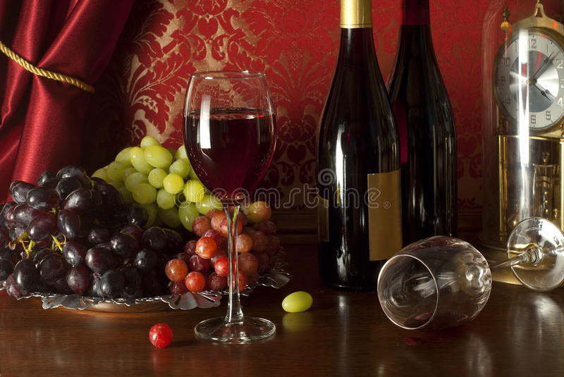 Red wine composition in retro style. stock image