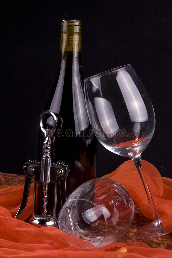 Red wine, corkscrew and glasses royalty free stock photo