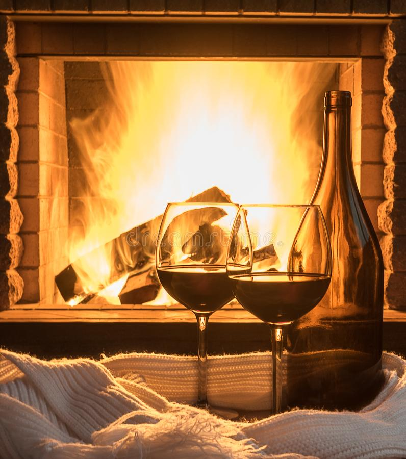Red wine on cozy fireplace background, close up. royalty free stock image