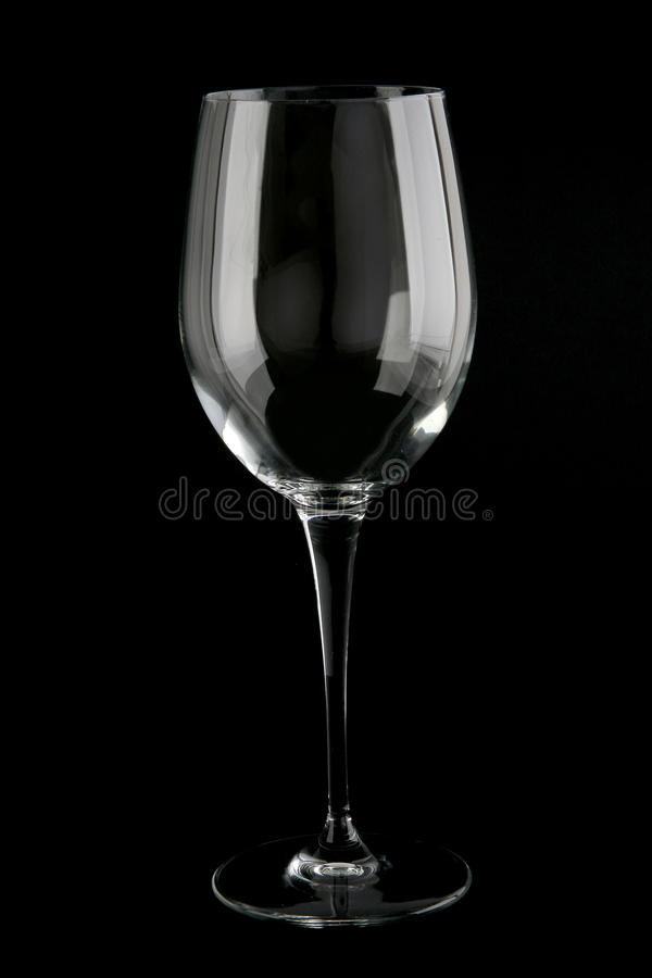 Red wine glass. Merlot/red wine glass on black background royalty free stock images