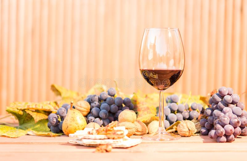 Red wine in a glass and autumn brunch stock photos