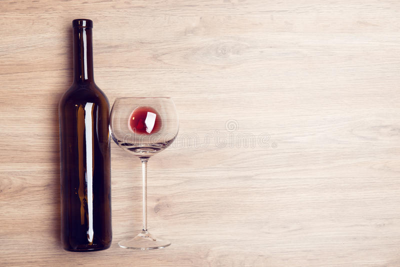 Download Red Wine Glass With Bottle On Wooden Ground Stock Image - Image: 83705457