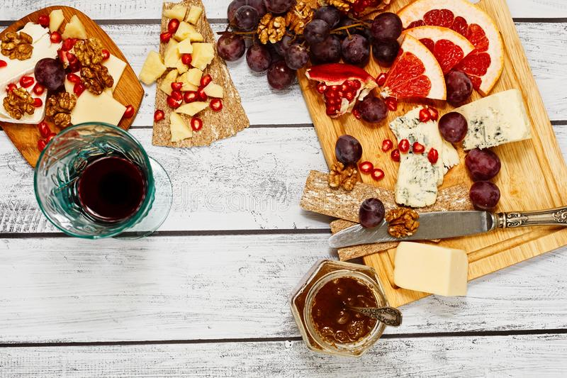 Red wine glass and cheese snack royalty free stock photos