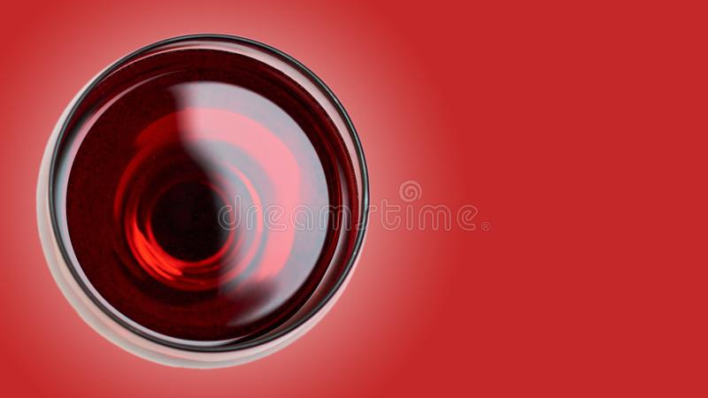 Red Wine in glass. on color background stock images