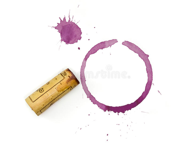 Red Wine Glass and Cork Stain. Red wine glass stain and cork stains with spatter and wine stained cork on a white background stock image