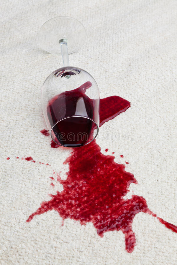 Red wine glass dirty carpet. stock image