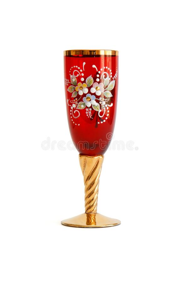 Red wine glass with flower pattern and a golden st royalty free stock photos