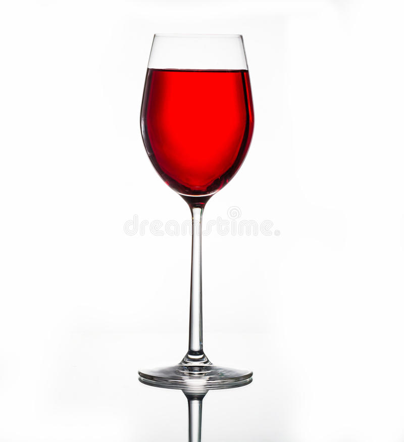 Red wine in glass isolated on white stock photography