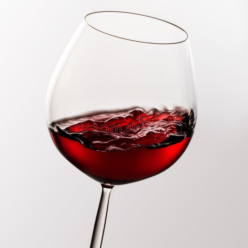 Red wine in glass with motion effect. stock photography