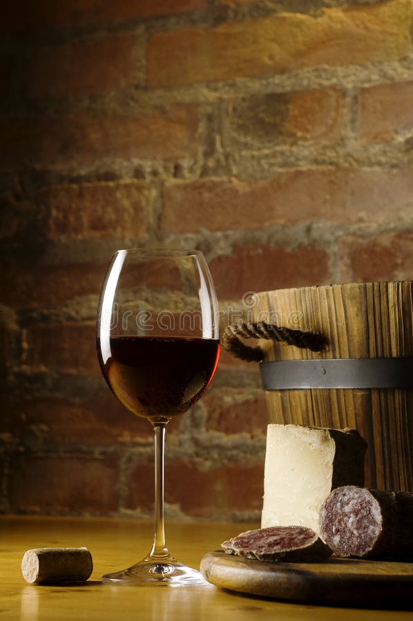 Red wine glass in rural kitchen stock photos