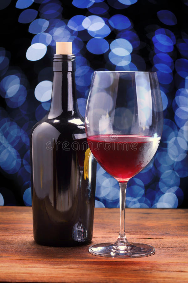 Red wine glasses on wooden table, background bokeh circles stock photos