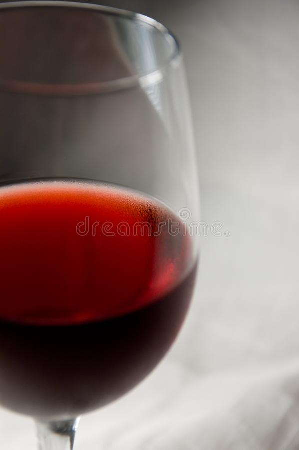 Red wine goblet-left cut royalty free stock image