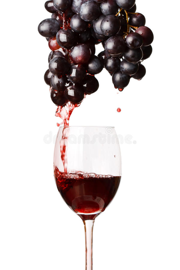 Red wine and grapes stock images