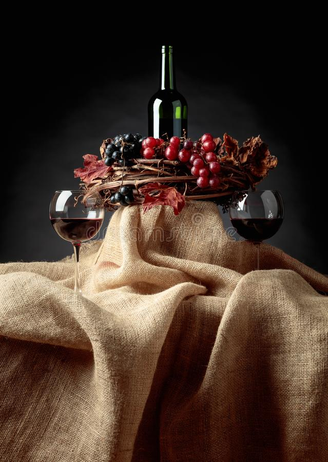 Red wine and grapes stock photo