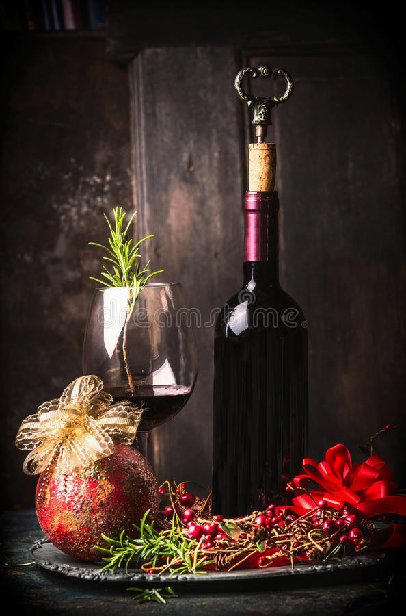 Free Red Wine In Goblet And Bottle With Festive Christmas Decoration At Dark Wooden Background Stock Image - 78450751