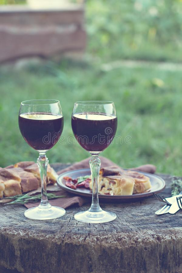 Red wine and light snacks, Grapes, wine, cheese, pie. stock photos
